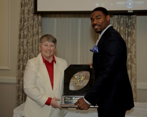 Traci Morris Drake with 2010 Morris Trophy winner Tyron Smith of USC.
