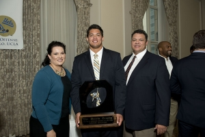 Su'a-Filo with his parents at the 2013 Morris Trophy luncheon.